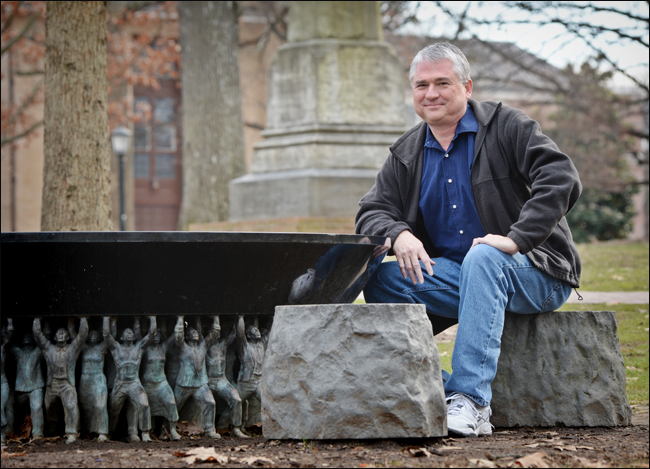 Dr. Time McMillan seated at the Unsung Founders Memorial Photo credit: University Gazette, University of North Carolina at Chapel Hill